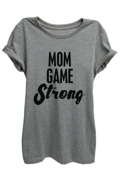 """Mom Game Strong"" is featured on a crew neck, short sleeves and a new modern, slim or relaxed fit for effortless style. Printed on quality constructed material, these shirts are perfect with a pair of"