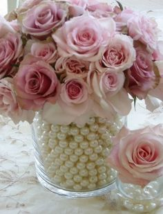 Flowers White Wedding Flowers---LOVE the pearls/beads around the bouquet. For the 'tossing' bouquet, ask your florist to make a small version with shorter stems and white beads. Unique Wedding Centerpieces, Wedding Table Decorations, Unique Weddings, Quinceanera Centerpieces, Communion Centerpieces, Graduation Centerpiece, Pearl Decorations, Centerpieces For Bridal Shower, Girl Baptism Decorations