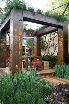 Flower Tower. Laser Cut Rust Copper Metal Pergola. Overhead Green Planting.                                                                                                                                                     More