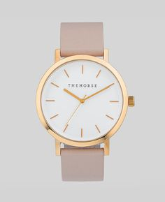 So gorgeous I might cry.   New to the stables, this rose gold / white face / blush leather watch is a simple take on the classic time-teller. Featuring a polished rose gold coated stainle