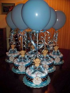 Something like this w/baby rajahs as the table toppers.