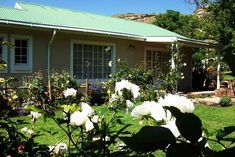Iona Cottage - Clarens Accommodation. Sandstone Wall, Queen Room, West Coast Scotland, Self Catering Cottages, Free State