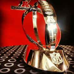 The Lamar Hunt AFC championship trophy, awarded to the American Football Conference champion of the NFL. Football Awards, Nfl Football Teams, Football Is Life, Football And Basketball, Go Broncos, Denver Broncos, Lamar Hunt, Broncos Pictures, Soccer Cup