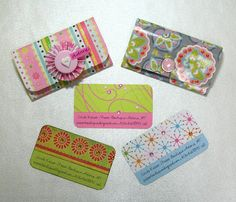 Paper crafted business cards with holders.