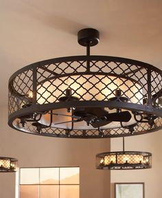 """The unique design of the Brighton Court ceiling fan is classified as a """"fandelier"""" – a decorative exterior shade covering a small, gentle fan within. The outer basket weave metal shade has a high-end, rustic look inspired by the Mountain Luxe design trend. The inner fabric shade conceals the fan and is surrounded by ten integrated lights using candelabra bulbs. #MonteCarlo #CeilingFans #Fandelier"""