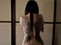 Angel wings tattoo - Angel wings are the main attribute of angel, which is the messenger of God in human form. Angel tattoo is another religeous tattoo for expressing love of God.