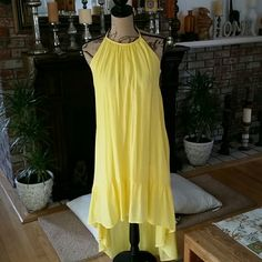 Summer yellow adorable halter dress with tie back. This dress is perfect for any summer occasion.   Wedding, errands, beach.  You can dress it up or bring it down depending on choice of shoe and accessories.   So cute, only wore once. Olsenboye Dresses High Low