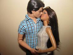 Peter Jarrod and his wife, Nancy (Superman Ken doll and On Location Monte Carlo Barbie) lock lips for the camera.