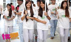Female snooze ambassadors in pyjamas go out to encourage more sleep