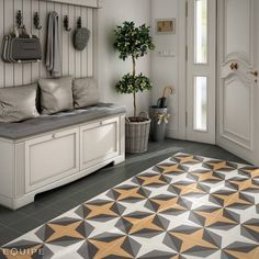 Colonial corridor, hallway & stairs by Equipe Ceramicas. We just love that gray combination and the pop of light yellow from the mosaic floor. We are in love!