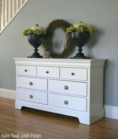 """My client, who is expecting her first baby, purchased a Stanley seven drawer dresser from Craigslist to use as a changing table. She asked me to paint it for her and decided on a soft white since that would fit best with her decor over the long run."
