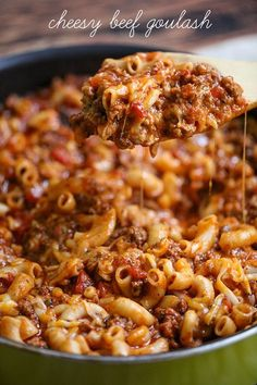 Cheesy Beef Ghoulash - a delicious, hearty and cheesy dinner recipe full of lots of flavors, tomatoes, elbow macaroni, and hamburger, the entire family will love.