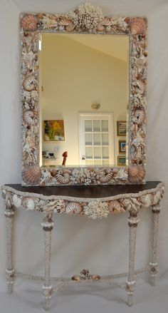 This seashell console and mirror were made with polished and natural seashells in brown tones for a client in Atlantic Beach. www.elegantshells.com