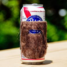 Kevin - Philadelphia-based arms & ink studios have designed these humorous & manly cozies that give your can of beer a beard. Made from craft fur & a wide band of elastic, these cozies are currently available to purchase at Fab.