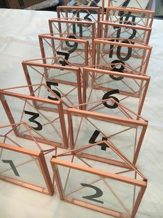 Table numbers! Umbra frames and number stickers. Geometric. Copper. Modern wedding.