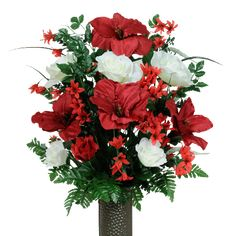 Red Amaryllis Mix (LG1266) A mix of red amaryllis, cream roses, red Christmas cactus and greenery designed for ground vases. Perfect for Christmas for your loved one!