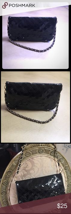 Ann Taylor loft Handbag This bag is for night out handle has gold trim on handle and in front. This bag looks new. Black with gold hardware. Stunning bag Ann Taylor Bags Clutches & Wristlets
