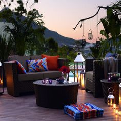 Outdoor decking area at twiling with wicker sofa, armchair and coffee table