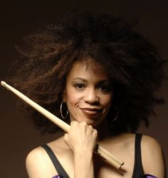 Cindy Blackman, jazz & rock drummer and bandleader. She is best known for recording and touring with Lenny Kravitz, as well as appearing in his music videos, including  Are You Gonna Go My Way. She has recorded several jazz albums, and has performed with acclaimed jazz & rock artists. A rarity as a female jazz percussionist, she has admitted she has encountered gender & racial prejudice, as well as prejudice against her afro & musical opinions. She is married to guitarist Carlos Santana.