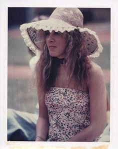 """Stevie, in that unforgettable strapless floral sundress and hat at the time of """"Tusk"""" video production with the USC Trojan marching band Tusk, 1979  ~ ☆♥❤♥☆ ~ https://www.pinterest.com/source/goldduststevie.tumblr.com/"""