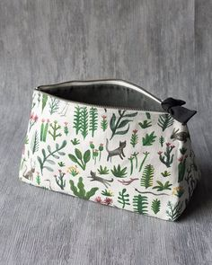 Secret Garden Large Cosmetic Bag - A large cosmetic bag made from 100% linen is perfect for storing your beauty essentials, accessories, toiletries and more. The zipper is complete with a black tie for tactile appeal. Lively illustrations of birds, felines, reptiles and rabbits bound through the underbrush amongst fantastical foliage. Large Cosmetic Bag, Birthday Supplies, Travel Organization, Sell On Amazon, Beauty Essentials, S Star, Bag Making, Vegan Leather, Traveling By Yourself
