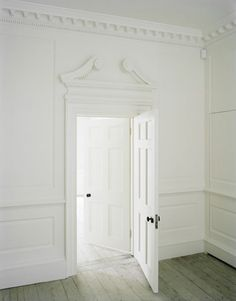 a grand white door.