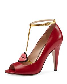"""Gucci leather pump with hand-embroidered mouth appliqu. 4"""" covered heel. Open toe. T-strap vamp. Adjustable ankle strap. Smooth outsole. """"Molina"""" is made in Italy."""