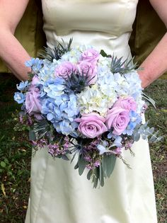 Blue hydrangea are accented by clusters of lavender roses.  Designed by Stein Your Florist Co. for the Philadelphia Great Bridal Expo.