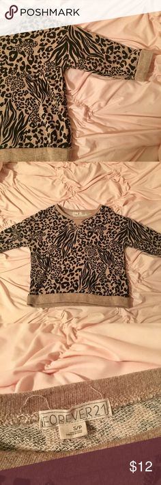 Light weight sweat shirt Animal print, gently used. Looks and feels brand new. Forever 21 Tops Sweatshirts & Hoodies
