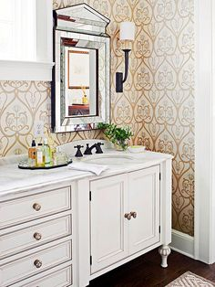 True to Tradition.  In the master bath, the oversize tone-on-tone wallpaper is a modern counterpoint to the vanity's traditional profile.