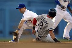 Boston Red Sox's Jacoby Ellsbury, right, steals second as Los Angeles Dodgers shortstop Nick Punto takes a late throw from home during the third inning of their baseball game, Sunday, Aug. 25, 2013, in Los Angeles. (AP Photo/Mark J. Terrill)