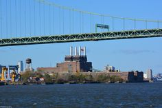 Pink looks more in its element, hovering between the stacks of Southwark Generating Station on the bank of the Delaware River in South Philadelphia. The Walt Whitman Bridge is shown as well.