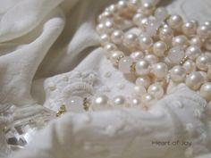 Lakshmi Mala - pearls and rose quartz with crystal quartz guru bead.