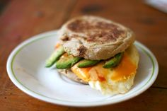 Top a fried egg with low-fat cheese, avocado slices and Frank's RedHot, sandwiched between a 100-calorie English muffin using avocado also as the spread.