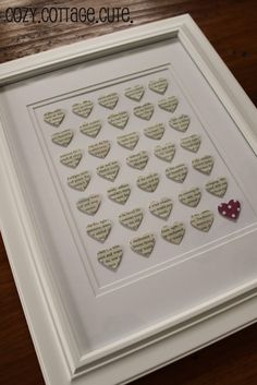 Heart Punch Art - DIY: punch out 35 hearts from an old dictionary, choosing words to describe the person you want to give it to, and arrange them into a frame for a decoration.
