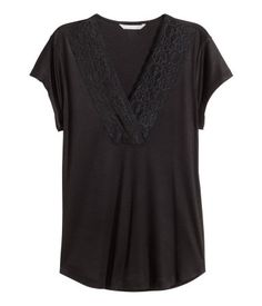 Black. Fitted top in soft, gently draping jersey with a slight sheen, with a…