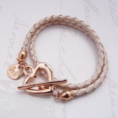 Pleated leather double wrap bracelet finished with a rose gold plated hammered heart t-bar fastener. Size: 36cm  SKU: 30B7015