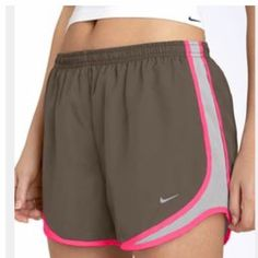 Nike Tempo Shorts Dry fit, brown with pink and white. No flaws, perfect condition. All reasonable offers are welcome! Please make all offers through the offer button Nike Shorts