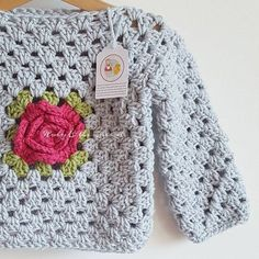 """Nothing new to show you tonight so I am sharing this grey rosey posey top again We have had an awful day with two trips to the doctors for poor…""""This Pin was discovered by BedNo automatic alt text available. Crochet Baby Sweaters, Crochet Baby Clothes, Knit Crochet, Knitting Sweaters, Crochet Granny, Knitting For Kids, Crochet For Kids, Baby Knitting, Knitting Patterns"""