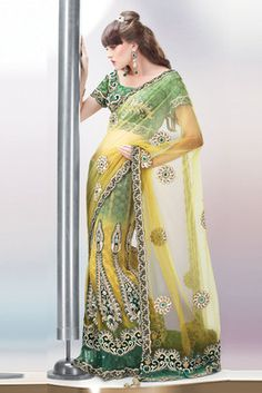 Yellow and  green  art silk and  net and  velvet embroidered unstithched lehenga…