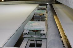 Moisture measurement for gypsum fiberboards. The moisture sensors are mounted under the production line.