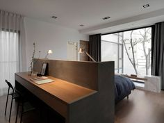 Bedroom Design Idea – A Desk Built Into The Back Of The Headboard