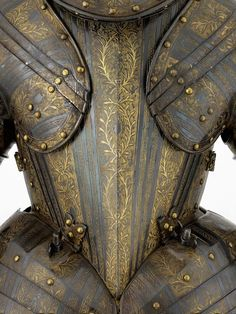 Cuirassier armour of Henry, Prince of Wales, detail view, French made, about 1607, iron or steel etched and gilt with later bluing. Presented by Claude de Lorraine, Prince de Joinville (1578-1657), to Henry, Prince of Wales (1594-1612) in 1607, etched bands of roping, foliage, palm fronds, feathers, on hatched ground or in relief field. includes helmet; gorget; breast/backplates; tassets w extensions; arm defences; cullet.