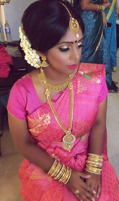 Deep Pink Silk Saree with Gold Jewelry and Jasmine Flowers on a South Indian Bride