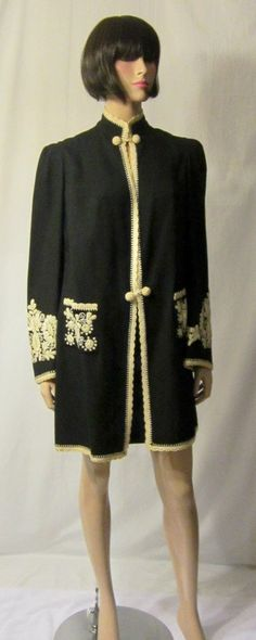 This is an exceptionally beautiful Edwardian (1901-1919) black woolen jacket with elaborately hand-embroidered sleeves and pockets and hand-crocheted trim. There are four hand-crocheted covered buttons for closure. The jacket would accommodate a Size Small to Size Medium figure type and is in excellent vintage condition.