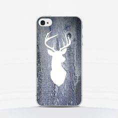 White deer on wooden background -  it's an unusual way to change the look of your phone.