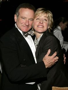 Robin Williams chats with Ellen Degeneres at the HBO party after the 62nd annual Golden Globe Awards in Beverly Hills, Calif., on Jan. 16, 2005.
