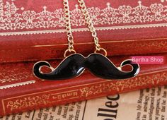 Moustache necklace, the necklace of style restoring ancient ways.. $2.99, via Etsy.