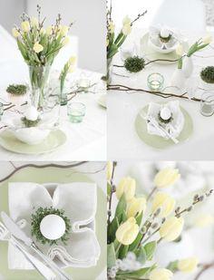 Natuurlijke-paastafel . Met een tak van een krulhazelaar op tafel en tulpen en katjes in vaasjes verdeeld over de tafel is het een gezellig geheel.