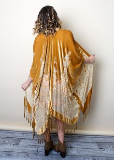 Deep, rich mustard velvet jacket dripping with iridescent mustard and clear beads. Stunning floral burnout design on thick silk velvet burnout panels. Heavy webbed beaded tassels at the hemline.Wear o